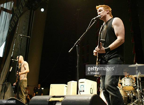 Nick Oliveri and Josh Homme of Queens of the Stone Age