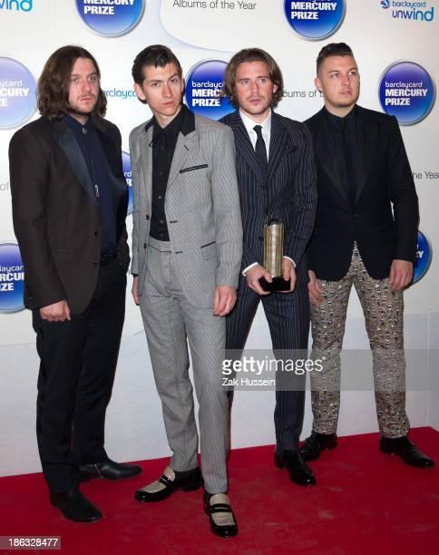 Nick O'Mailey Alex Turner Matt Holders and Jamie Cook of Arctic Monkeys attend the Barclaycard Mercury Prize at The Roundhouse on October 30 2013 in...