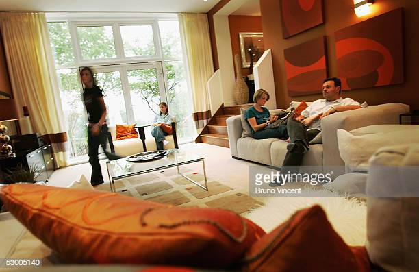 Nick Parnell his wife Sue and his daughters Lucy and Hazel pose for photographs during their first day living in their hitech 'Study Home' June 1...