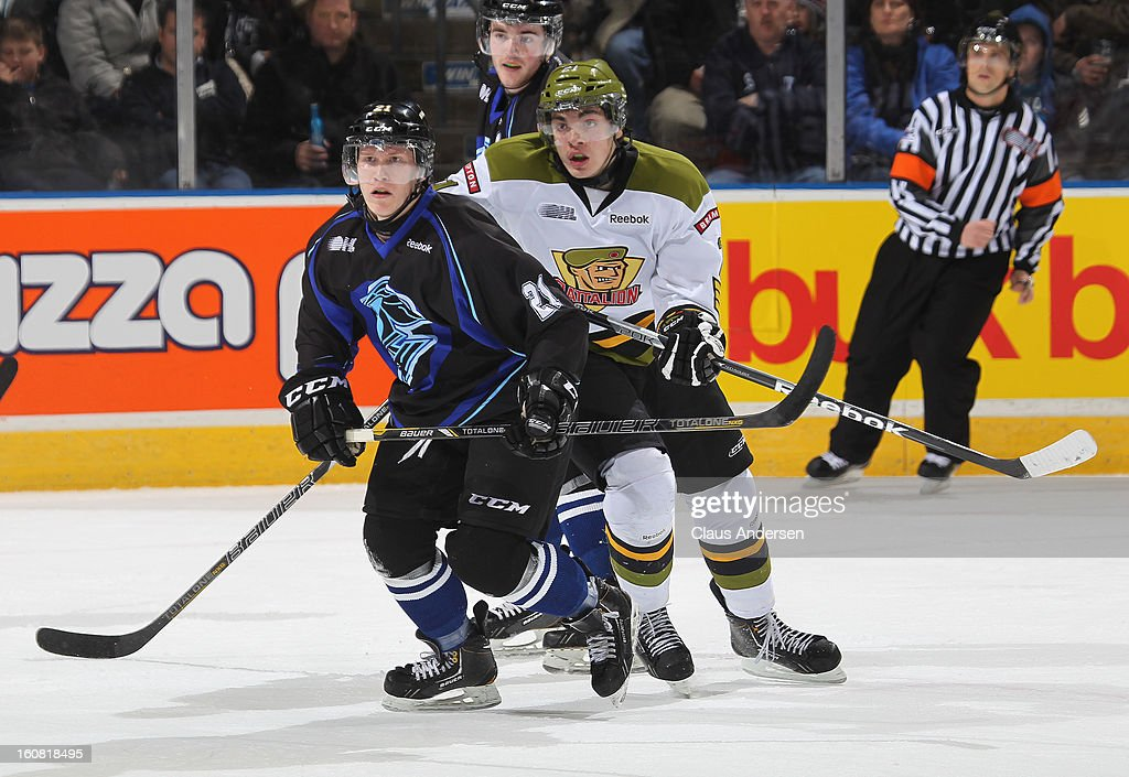 Nick Paul #21 of the Brampton Battalion is covered by Tyler Ferry #21 of the London Knights in an OHL game on February 1, 2013 at the Budweiser Gardens in London, Canada. The Knights defeated the Battalion 1-0 in a shoot-out.