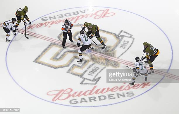 Nick Paul of the North Bay Battalion takes a faceoff against Michael McCarron of the London Knights in an OHL game at Budweiser Gardens on December 7...