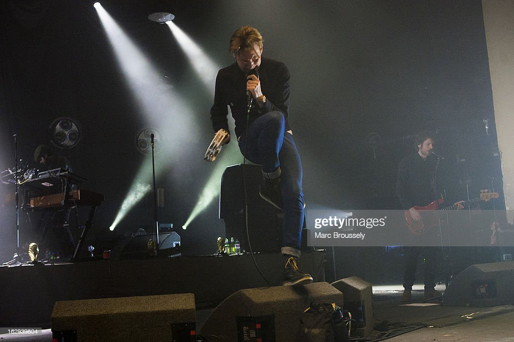 Nick 'Peanut' Baines, Ricky Wilson and Simon Rix of Kaiser Chiefs perform on stage at Hammersmith Apollo on March 1, 2013 in London, England.