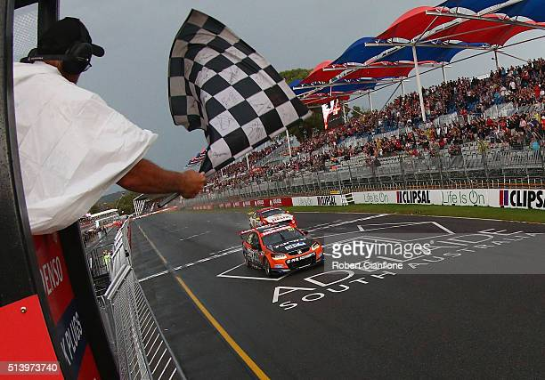 Nick Percat driving the Lucas Dumbrell Motorsport Holden takes the chequred flag to win race three of the V8 Supercars Clipsal 500 at Adelaide Street...