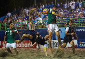 Nick Perera of USA tries a bicycle kick as Francisco Cati of Mexico during day six of the CONCACAF Beach Soccer Championships El Salvador 2015 match...