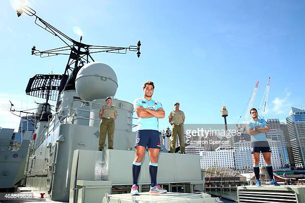 Nick Phipps and Dave Dennis of the Waratahs pose with Warrant Officer Nadia McCulloch and Major Andrew McCulloch onboard the HMAS Vampire during a...