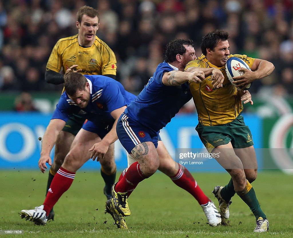 Nick Phipps of Australia is tackled by Thomas Domingo of France during the Autumn International match between France and Australia at Stade de France on November 10, 2012 in Paris, France.