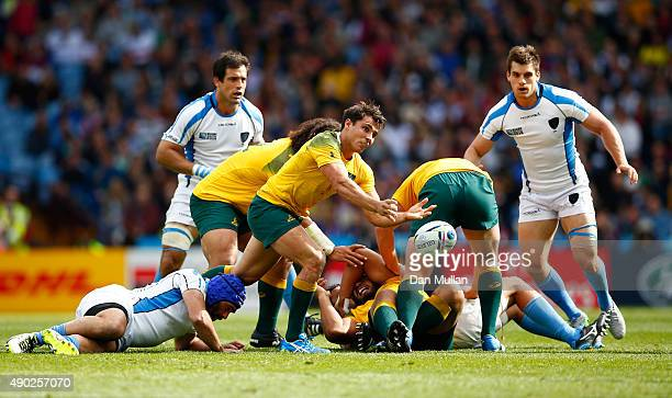 Nick Phipps of Australia passes the ball during the 2015 Rugby World Cup Pool A match between Australia and Uruguay at Villa Park on September 27...