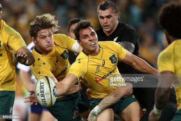 Nick Phipps of the Wallabies passes as he is tackled during The Rugby Championship Bledisloe Cup match between the Australian Wallabies and the New...