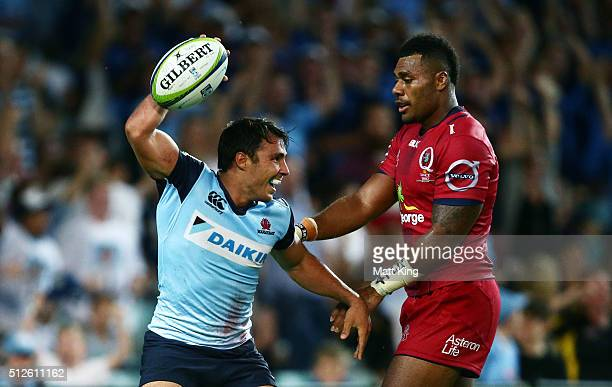 Nick Phipps of the Waratahs celebrates scoring a try during the round one Super Rugby match between the Waratahs and the Reds at Allianz Stadium on...