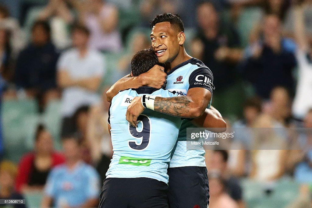Nick Phipps of the Waratahs celebrates scoring a try with team mate Israel Folau during the round one Super Rugby match between the Waratahs and the...