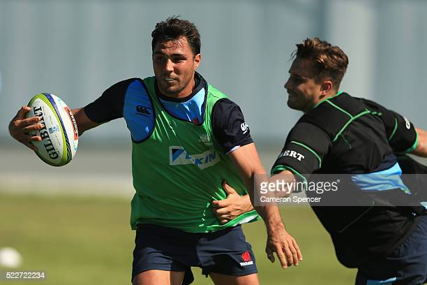 Nick Phipps of the Waratahs is tackled during a Waratahs Super Rugby training session at Moore Park on April 21 2016 in Sydney Australia
