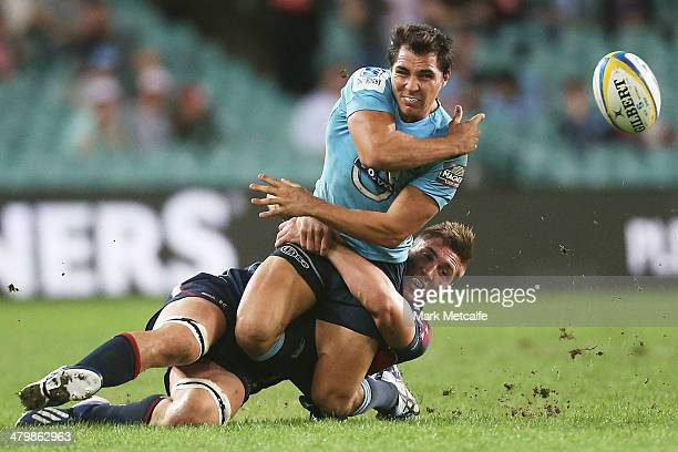 Nick Phipps of the Waratahs is tackled during the round six Super Rugby match between the Waratahs and the Rebels at Allianz Stadium on March 21 2014...
