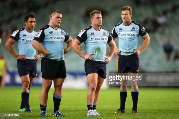 Nick Phipps Tom Robertson Hugh Roach and Cam Clark of the Waratahs look dejected at fulltime during the round nine Super Rugby match between the...