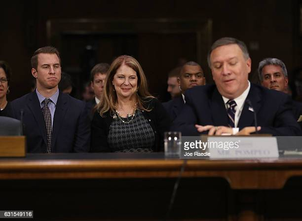 Nick Pompeo and Susan Pompeo look on at their husband and father US Presidentelect Donald Trump's nominee for the director of the CIA Rep Mike Pompeo...