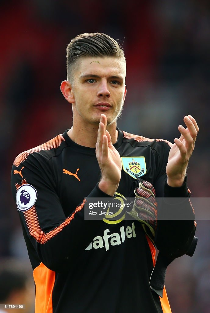 Nick Pope of Burnley shows appreciation to the fans after the Premier League match between Liverpool and Burnley at Anfield on September 16, 2017 in Liverpool, England.
