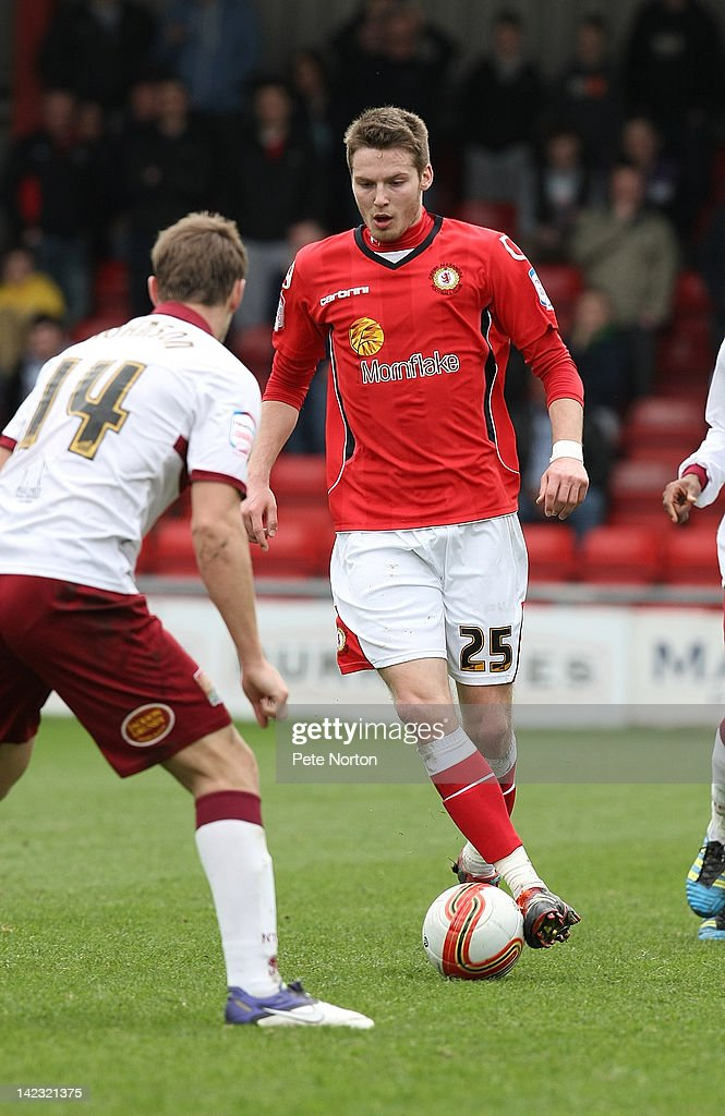 Nick Powell of Crewe Alexandra moves against John Johnson of Northampton Town during the npower League Two match between Crewe Alexandra and Northampton Town at The Alexandra Stadium on March 31, 2012 in Crewe, England.