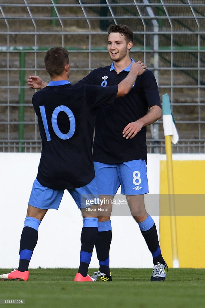 Nick Powell (R) of England celebrates after scoring their first goal during the Under 19 international friendly match between Germany and England at Stadion an der Lohmuehle on September 6, 2012 in Luebeck, Germany.