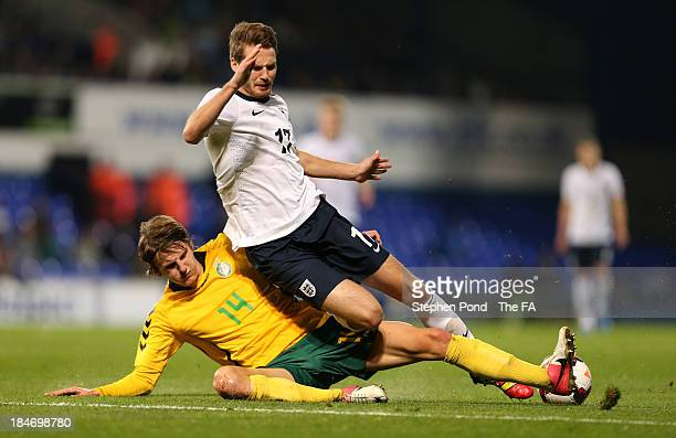 Nick Powell of England in action against Edvinas Girdvainis of Lithuania during the 2015 UEFA European U21 Championships Qualifying Group One match...