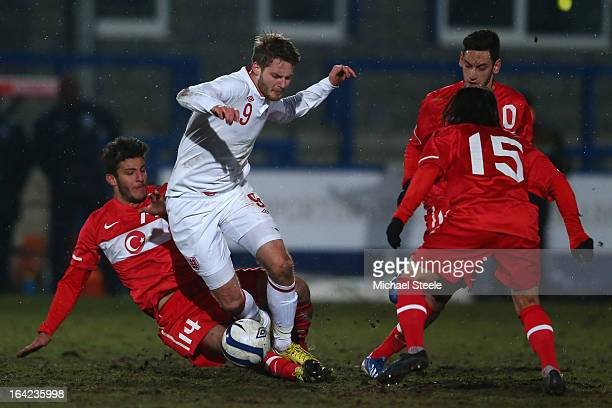 Nick Powell of England is fouled by Hakan Cinemre of Turkey during the England U19's versus Turkey U19's International match at New Bucks Head...