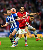 Nick Powell of Wigan Athletic Mikel Arteta and Thomas Vermaelen of Arsenal compete for the ball during the FA Cup SemiFinal match between Wigan...