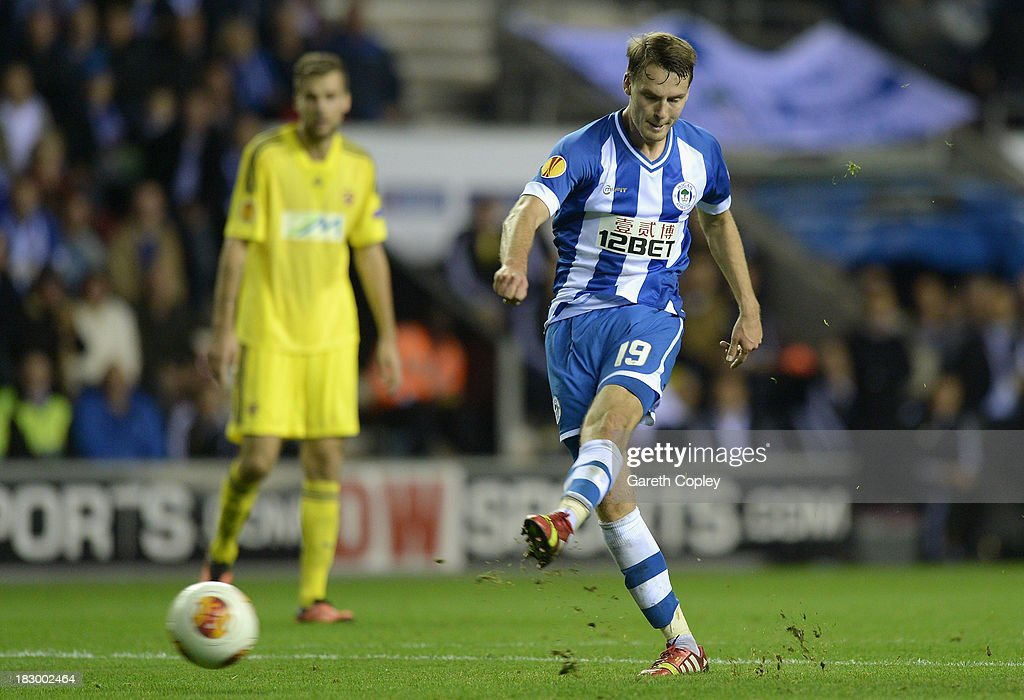 Nick Powell of Wigan scores his team's 3rd goal during the UEFA Europa League match between Wigan and NK Maribor at DW Stadium on October 3, 2013 in Wigan, England.