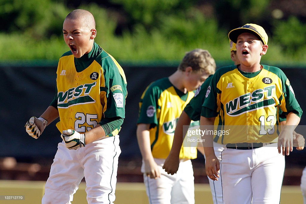 Nick Pratto #25 of the West team from Huntington Beach, California celebrates after driving in the winning run to defeat the Japan team from Hamamatsu City, Japan 2-1 to win the Little League Wolrd Series championship game on August 28, 2011 in South Williamsport, Pennsylvania.