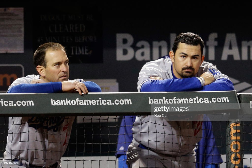 <a gi-track='captionPersonalityLinkClicked' href=/galleries/search?phrase=Nick+Punto&family=editorial&specificpeople=547246 ng-click='$event.stopPropagation()'>Nick Punto</a> #7 and Adrian Gonzalez #23 of the Los Angeles Dodgers look on from the dugout in the ninth inning of their 6-1 loss to the Baltimore Orioles during game two of a double header at Oriole Park at Camden Yards on April 20, 2013 in Baltimore, Maryland.