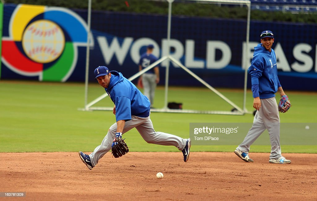 <a gi-track='captionPersonalityLinkClicked' href=/galleries/search?phrase=Nick+Punto&family=editorial&specificpeople=547246 ng-click='$event.stopPropagation()'>Nick Punto</a> #8 of Team Italy fields ground balls during the workout day for the 2013 World Baseball Classic on March 11, 2013 at Marlins Park in Miami, Florida.