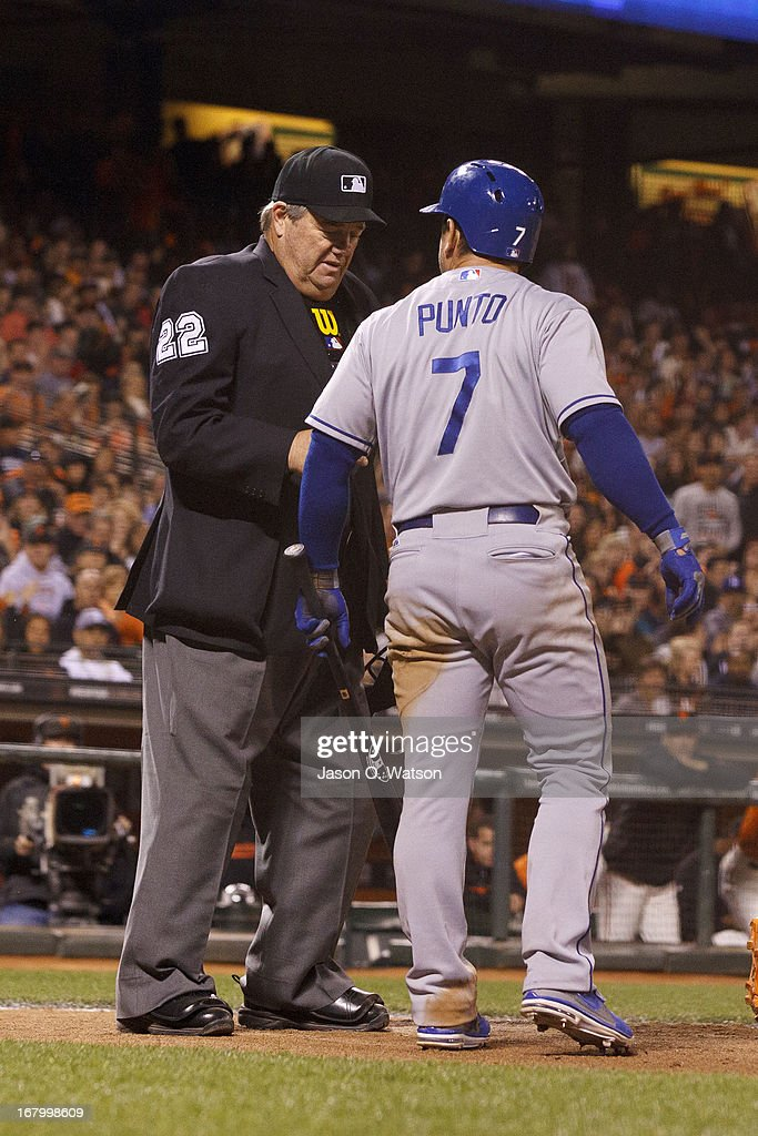 Nick Punto of the Los Angeles Dodgers argues a called third strike with umpire Joe West in the ninth inning against the San Francisco Giants at ATT...
