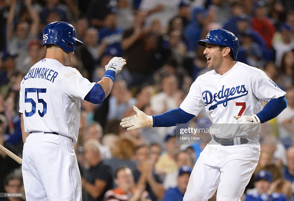 <a gi-track='captionPersonalityLinkClicked' href=/galleries/search?phrase=Nick+Punto&family=editorial&specificpeople=547246 ng-click='$event.stopPropagation()'>Nick Punto</a> #7 of the Los Angeles Dodgers celebrates his solo homerun with <a gi-track='captionPersonalityLinkClicked' href=/galleries/search?phrase=Skip+Schumaker&family=editorial&specificpeople=640599 ng-click='$event.stopPropagation()'>Skip Schumaker</a> #55 to take a 4-2 lead over the New York Mets at Dodger Stadium on August 12, 2013 in Los Angeles, California.