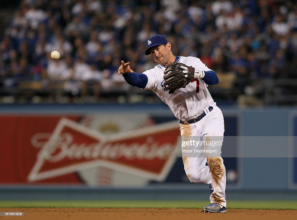<a gi-track='captionPersonalityLinkClicked' href=/galleries/search?phrase=Nick+Punto&family=editorial&specificpeople=547246 ng-click='$event.stopPropagation()'>Nick Punto</a> #7 of the Los Angeles Dodgers fields a throw to first base for the third out in the second inning during the MLB game against the Colorado Rockies at Dodger Stadium on April 30, 2013 in Los Angeles, California. The Dodgers defeated the Rockies 6-2.