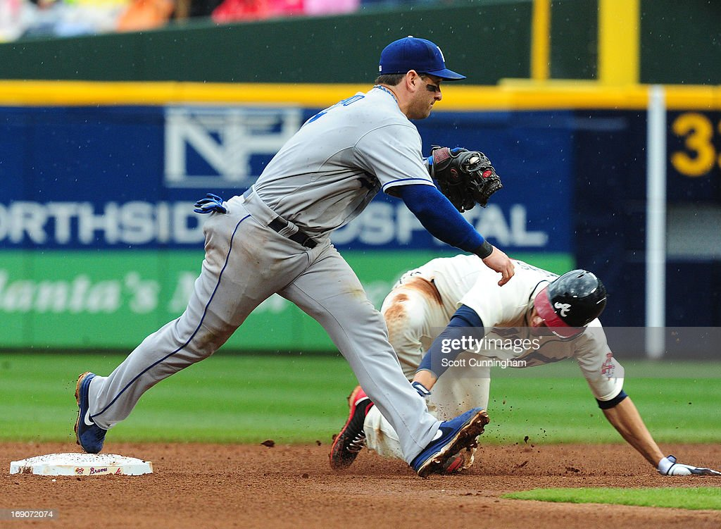 <a gi-track='captionPersonalityLinkClicked' href=/galleries/search?phrase=Nick+Punto&family=editorial&specificpeople=547246 ng-click='$event.stopPropagation()'>Nick Punto</a> #7 of the Los Angeles Dodgers takes a throw at second base to force out <a gi-track='captionPersonalityLinkClicked' href=/galleries/search?phrase=Andrelton+Simmons&family=editorial&specificpeople=8978424 ng-click='$event.stopPropagation()'>Andrelton Simmons</a> #19 of the Atlanta Braves at Turner Field on May 19, 2013 in Atlanta, Georgia.