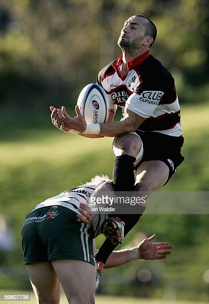Nick Reily of West Harbour jumps for the ball as he's being tackled by Beau Robinson of Warringah during the round 20 Shute Shield match between...