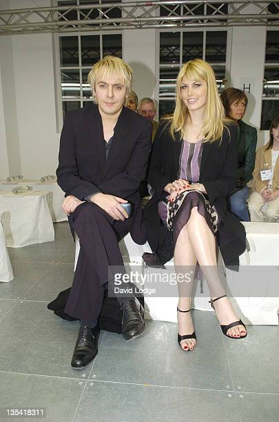 Nick Rhodes and Meredith Ostrom during London Fashion Week Autumn/Winter 2006 Giles Front Row at Victoria Square in London Great Britain