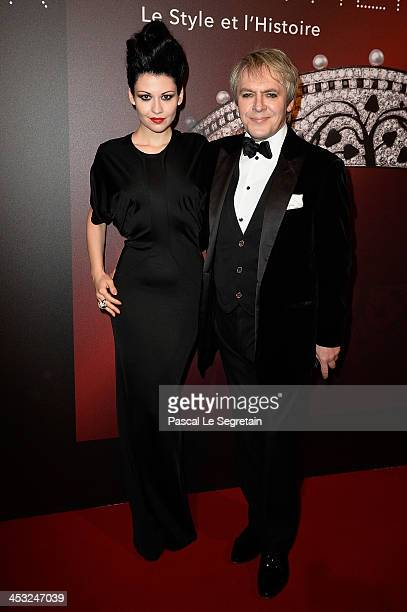Nick Rhodes and Nefer Suvio arrive at the 'Cartier Le Style et L'Histoire' Exhibition Private Opening at Le Grand Palais on December 2 2013 in Paris...