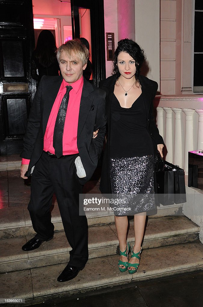 <a gi-track='captionPersonalityLinkClicked' href=/galleries/search?phrase=Nick+Rhodes&family=editorial&specificpeople=206732 ng-click='$event.stopPropagation()'>Nick Rhodes</a> and Nefer Suvio attend a dinner hosted by W Magazine and Jimmy Choo on October 11, 2012 in London, England.