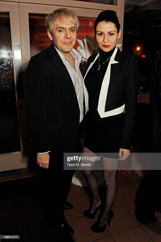 <a gi-track='captionPersonalityLinkClicked' href=/galleries/search?phrase=Nick+Rhodes&family=editorial&specificpeople=206732 ng-click='$event.stopPropagation()'>Nick Rhodes</a> and Nefer Suvio attend the Katie Grand & Olivier Rousteing LOVE Christmas Party, hosted by Balmain, at Shrimpy's on December 18, 2012 in London, England.
