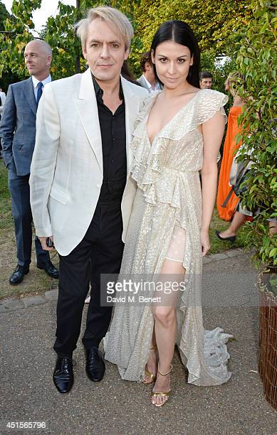 Nick Rhodes and Nefer Suvio attend The Serpentine Gallery Summer Party cohosted by Brioni at The Serpentine Gallery on July 1 2014 in London England
