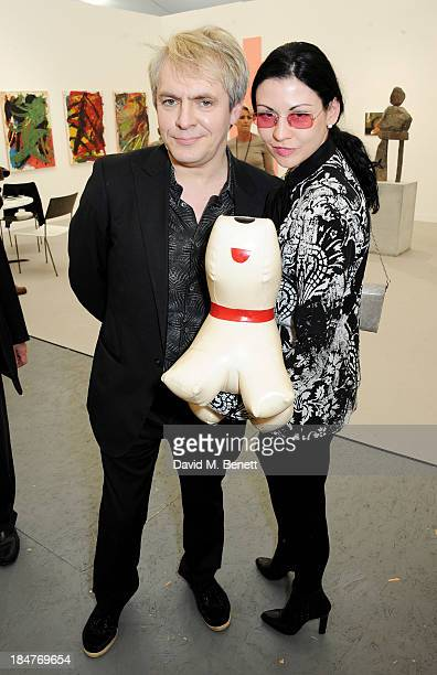 Nick Rhodes and Nefer Suvio attend the VIP preview of the annual Frieze Art Fair in Regent's Park on October 16 2013 in London England