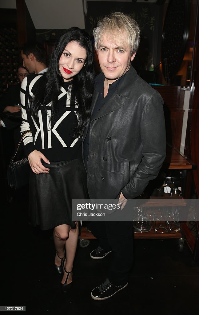Nick Rhodes (R) attends a dinner at China Tang after Moncler hosted the 'Monuments' Exhibition with Leica on October 14, 2014 in London, England.