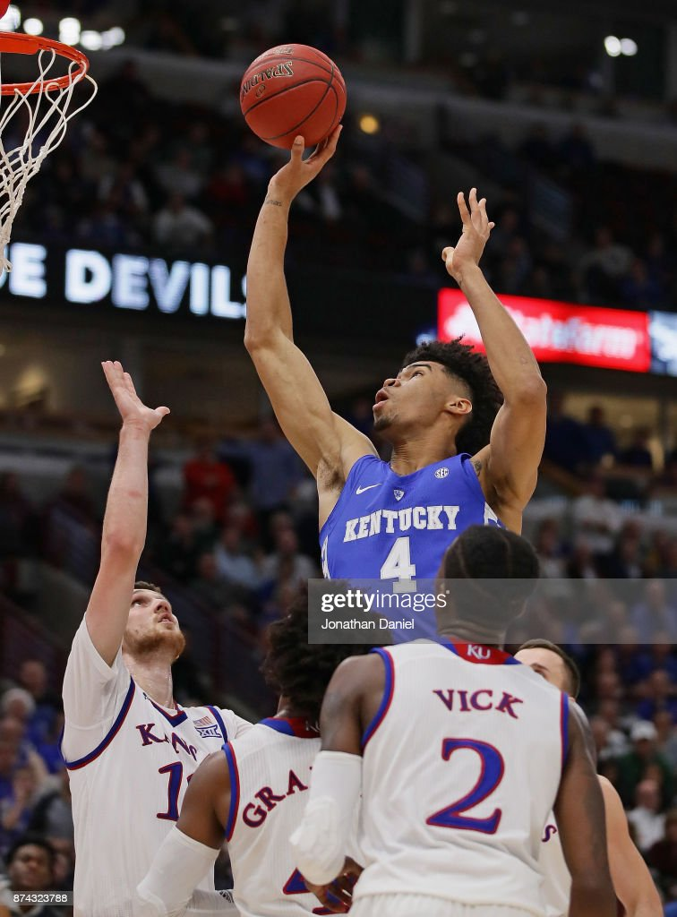 Nick Richards #4 of the Kentucky Wildcats shoots over (L-R) Sviatoslav Mykhailiuk #10, Devonte' Graham #4 and Lagerald Vick #2 of the Kansas Jayhawks during the State Farm Champions Classic at the United Center on November 14, 2017 in Chicago, Illinois. Kansas defeated Kentucky 65-61.