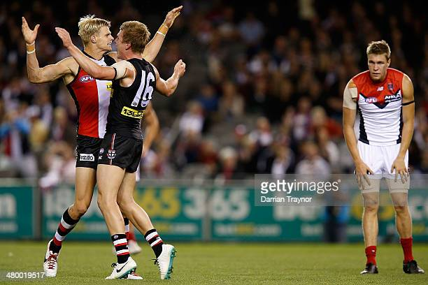 Nick Riewoldt and Jack Newnes of the Saints celebrate a goal during the round one AFL match between the St Kilda Saints and the Melbourne Demons at...