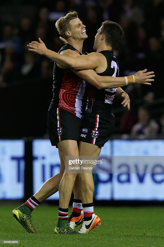 <a gi-track='captionPersonalityLinkClicked' href=/galleries/search?phrase=Nick+Riewoldt&family=editorial&specificpeople=176552 ng-click='$event.stopPropagation()'>Nick Riewoldt</a> and Jade Gresham of the Saints celebrate a goal during the round 10 AFL match between the St Kilda Saints and the Fremantle Dockers at Etihad Stadium on May 28, 2016 in Melbourne, Australia.