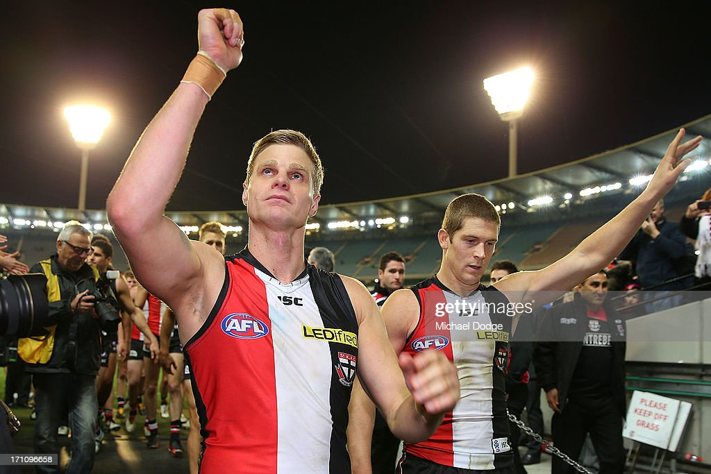 <a gi-track='captionPersonalityLinkClicked' href=/galleries/search?phrase=Nick+Riewoldt&family=editorial&specificpeople=176552 ng-click='$event.stopPropagation()'>Nick Riewoldt</a> (L) and <a gi-track='captionPersonalityLinkClicked' href=/galleries/search?phrase=Nick+Dal+Santo&family=editorial&specificpeople=213937 ng-click='$event.stopPropagation()'>Nick Dal Santo</a> thanks the fans after their 250th game during the round 13 AFL match between the St Kilda Saints and the Melbourne Demons at Melbourne Cricket Ground on June 22, 2013 in Melbourne, Australia.