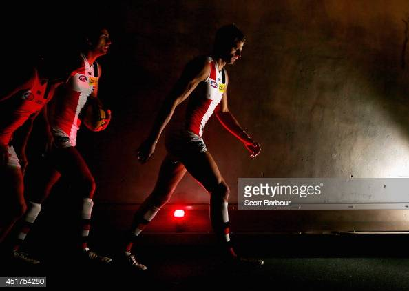 Nick Riewoldt leads the Saints onto the field during the round 16 AFL match between the Carlton Blues and the St Kilda Saints at Etihad Stadium on...