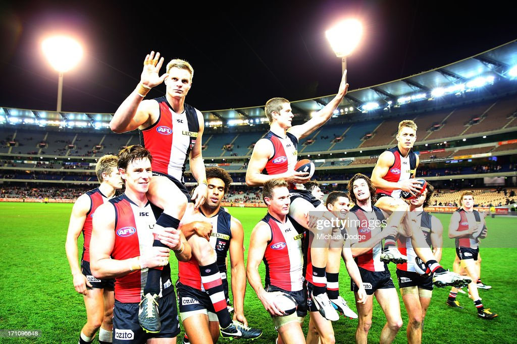 <a gi-track='captionPersonalityLinkClicked' href=/galleries/search?phrase=Nick+Riewoldt&family=editorial&specificpeople=176552 ng-click='$event.stopPropagation()'>Nick Riewoldt</a> (L) <a gi-track='captionPersonalityLinkClicked' href=/galleries/search?phrase=Nick+Dal+Santo&family=editorial&specificpeople=213937 ng-click='$event.stopPropagation()'>Nick Dal Santo</a> (C) and Sean Dempster get carried off for the milestone games during the round 13 AFL match between the St Kilda Saints and the Melbourne Demons at Melbourne Cricket Ground on June 22, 2013 in Melbourne, Australia.