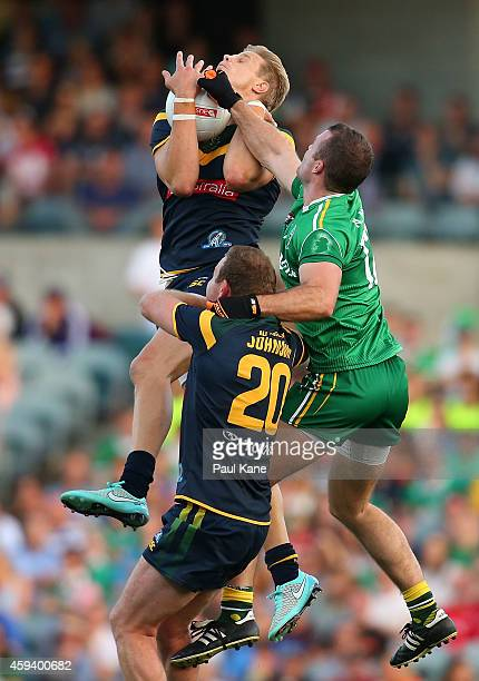 Nick Riewoldt of Australia marks the ball against Neil McGee of Ireland during the International Rules Test Match between Australia and Ireland at...