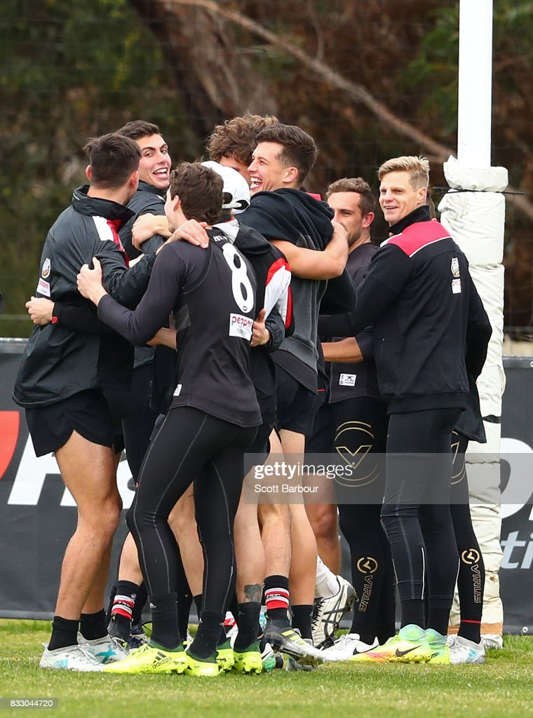 Nick Riewoldt of the Saints (R) and his teammates embrace during a training exercise during a St Kilda Saints AFL training session at Linen House Oval on August 17, 2017 in Melbourne, Australia.