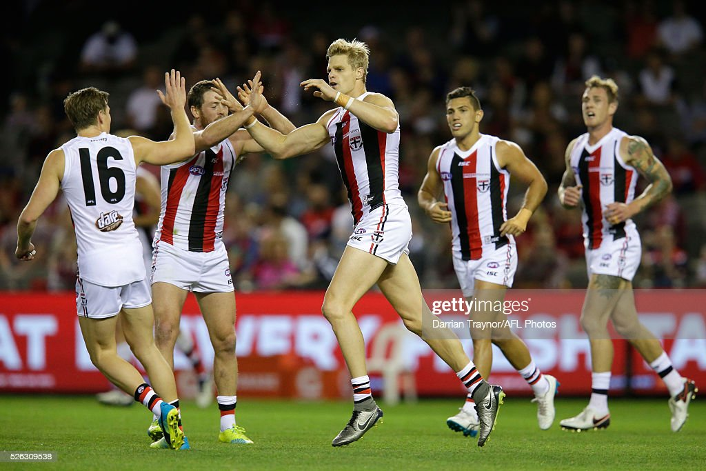 <a gi-track='captionPersonalityLinkClicked' href=/galleries/search?phrase=Nick+Riewoldt&family=editorial&specificpeople=176552 ng-click='$event.stopPropagation()'>Nick Riewoldt</a> of the Saints celebrates a goal with team mates during the round six AFL match between the Melbourne Demons and the St Kilda Saints at Etihad Stadium on April 30, 2016 in Melbourne, Australia.