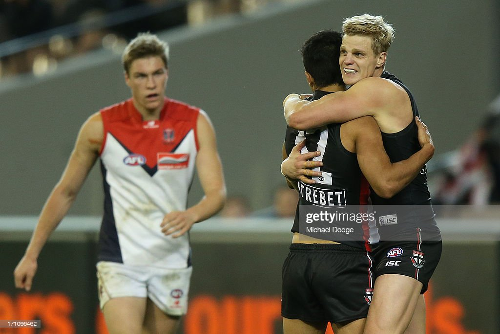<a gi-track='captionPersonalityLinkClicked' href=/galleries/search?phrase=Nick+Riewoldt&family=editorial&specificpeople=176552 ng-click='$event.stopPropagation()'>Nick Riewoldt</a> (r) of the Saints celebrates a goal with Terry Milera during the round 13 AFL match between the St Kilda Saints and the Melbourne Demons at Melbourne Cricket Ground on June 22, 2013 in Melbourne, Australia.